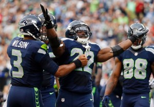 Russell Wilson congratulates Robert Turbin after a touchdown.  Photo by Seahawks.com