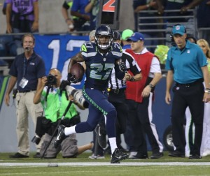 Tharold Simon returns an interception for a touchdown.  Play would be called back by penalty.  Photo from Seahawks.com
